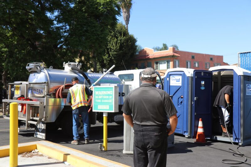 Cleaning porta-potties during vending hours.