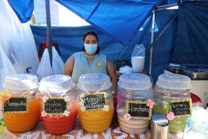 Arely Tafolla Garcia who sells aguas frescas right outside the LACC Swapmeet is one of the vendors who solely relies on her weekend sales to care for her and her family. She vends next to her mother and sister's stand where they sell tacos, pozole, and guisados.