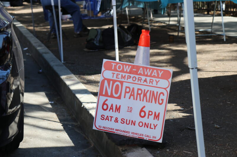 Parking signs went up recently. Vendors and nearby neighbors allege creates more problems for them.