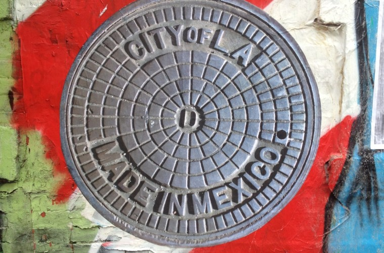manhole cover wheatpaste by TBDphotography